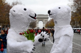 TOPSHOT - Activists dressed as polar bears are pictured as activists gather for a demonstration to form a giant red line at the Avenue de la Grande armee boulevard in Paris on December 12, 2015, as a proposed 195-nation accord to curb emissions of the heat-trapping gases that threaten to wreak havoc on Earth's climate system is to be presented at the United Nations conference on climate change COP21 in Le Bourget, on the outskirts of Paris.  AFP PHOTO / ALAIN JOCARD / AFP / ALAIN JOCARD        (Photo credit should read ALAIN JOCARD/AFP/Getty Images)